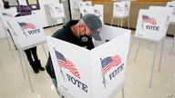 Chris Helps, of Earlham, Iowa, fills out his ballot during early voting, Tuesday, Oct. 20, 2020, in Adel, Iowa. (AP Photo…