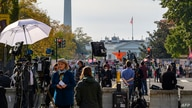 Journalists from all over the world wait for the result of the U.S. presidential elections on Black Lives Matter Plaza in front of the White House in Washington, D.C., Nov. 6, 2020.