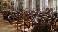 Church-goers wearing face masks attend a church service at Saint-Francois-Xavier church in Paris, France, Nov. 29, 2020.