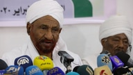 FILE - Former Sudanese Prime Minister Sadiq al-Mahdi, left, leader of the Umma political party, speaks during a press conference in Khartoum, Feb. 6, 2020.