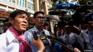 FILE - Uon Chhin and Yeang Sothearin, former journalists for U.S.-funded Radio Free Asia (RFA), speak to the media in front of the Municipal Court of Phnom Penh, in Phnom Penh, Cambodia, Oct. 3, 2019.