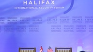 FILE - The backdrop and the Canadian and U.S. participants' chairs are seen at the Halifax International Security Forum, in Halifax, Nova Scotia, Canada, Nov. 22, 2013. Due to the coronavirus pandemic, this year's forum was held virtually.