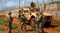 FILE - U.S. Army soldiers discuss security operations during a patrol in Somalia in December 2019. (Nick Kibbey/U.S. Air Force)