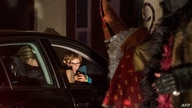 Members of the new circus company Cirk La Putyka, dressed as Saint Nicholases entertain people during their drive-thru…
