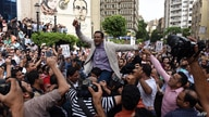 Khaled Elbalshy (C), board member of Egypt's Press Syndicate and the head of its Freedoms' Committee, demonstrates with…