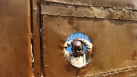 Five-year-old Peter Otieno stands in the inside courtyard of the preschool he attends in Kibera, the largest slum in Kenya on…