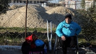 A disabled Palestinian waits for a travel permit to leave Gaza through Rafah border crossing after it was partially opened by…