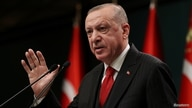 Turkish President Tayyip Erdogan talks during a news conference following a cabinet meeting in Ankara, Turkey, November 30,…