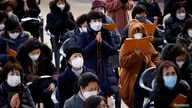 Buddhist believers pray for their children's success in the college entrance examinations amid the coronavirus disease (COVID…