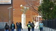 In this April 13, 2017 photo people walk near the main entrance to the Borough of Manhattan Community College in New York,…