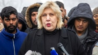 Surrounded by migrants, Dunja Mijatovic, the Council of Europe Commissioner for Human Rights addresses the media at the Vucjak…