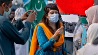 In this Friday, Sept. 11, 2020 photo, Mona Khan, a freelance female journalist, interviews during a rally, in Islamabad,…