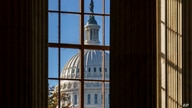 FILE - In this Nov. 10, 2020, file photo the morning sun illuminates the rotunda of the Russell Senate Office Building on…