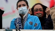 Aseefa Bhutto Zardari, left, a leader of the Pakistan Democratic Movement, an alliance of opposition parties, attends an anti-government rally, in Multan, Pakistan, Monday, Nov. 30, 2020.