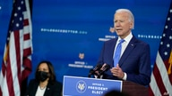 President-elect Joe Biden speaks as Vice President-elect Kamala Harris listens at left, during an event to introduce their economic team.
