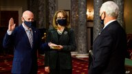 Sen. Mark Kelly, D-Ariz., with his wife former Rep. Gabby Giffords, D-Ariz., participates in a re-enactment of his swearing-in…