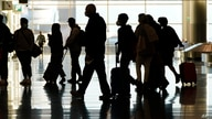 FILE - Air travelers line up to go through a a security checkpoint at Salt Lake City, Utah.