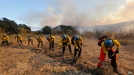 A hotshot hand crew works on a fireline while the Bond Fire burning in Silverado, Calif., on Thursday, Dec. 3, 2020. (AP Photo…