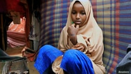 Nurta Mohamed, 13, a Somali girl sits inside her mother's makeshift shelter after she ran away from a suspected forced marriage…