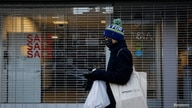 A shopper passes by a retail store that was recently closed in Brooklyn, New York, U.S., December 8, 2020.  REUTERS/Brendan…