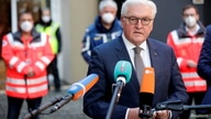 German President Frank-Walter Steinmeier speaks during a visit at a coronavirus disease (COVID-19) vaccination center in Berlin…