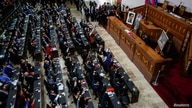 People raise their hands during the swear-in ceremony of Venezuela's National Assembly new term, in Caracas, Venezuela, January…
