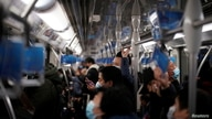 People wearing face masks ride a subway train following the coronavirus disease (COVID-19) outbreak, in Shanghai, China January…