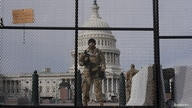 National Guard members stand guard outside the U.S. Capitol ahead of U.S. President-elect Joe Biden's inauguration, in…