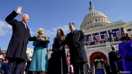 Joe Biden is sworn in as the 46th president of the United States by Chief Justice John Roberts as Jill Biden holds the Bible…