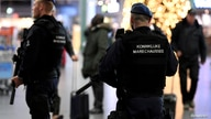 FILE PHOTO: Dutch police patrol at Amsterdam's Schiphol airport, November 6, 2019.  REUTERS/Piroschka van de Wouw/File Photo