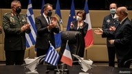 French Defence Minister Florence Parly and her Greek counterpart Nikos Panagiotopoulos applaud after the signing of an…