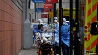 Medical workers move a patient between ambulances outside of the Royal London Hospital amid the spread of the coronavirus…