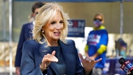 Jill Biden speaks to reporters while campaigning for her husband Democratic presidential candidate and former Vice President…