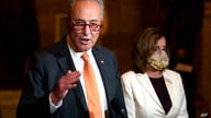 FILE - In this Aug. 6, 2020, file photo Senate Minority Leader Sen. Chuck Schumer of N.Y., speaks to reporters as House Speaker…