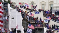 Trump supporters gather outside the Capitol, Wednesday, Jan. 6, 2021, in Washington. (AP Photo/John Minchillo)