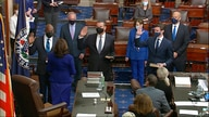 In this image from video, Vice President Kamala Harris swears in Sen. Raphael Warnock, D-Ga., Sen. Alex Padilla, D-Calif., and…