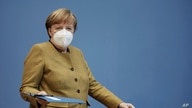 German Chancellor Angela Merkel arrives at a press conference in Berlin, Jan. 21, 2021.