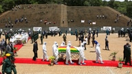 Pallbearers carry the coffin of a government minister of Dr Ellen Gwaradzimba who died of COVID-19, at the Heroes Acre in…
