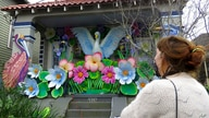 Designer, Caroline Thomas looks at a house decorated like a parade float in New Orleans on Friday, Jan. 8, 2021. All around the…