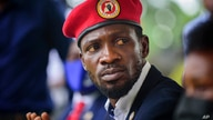 Opposition presidential challenger Bobi Wine, speaks to the media outside his home, in Magere, near Kampala, in Uganda Tuesday,…