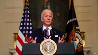 President Joe Biden delivers remarks on COVID-19, in the State Dining Room of the White House, Tuesday, Jan. 26, 2021, in…