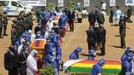 Three coffins of  Minister of Foreign Affairs Sibusiso Moyo, Transport Minister Joel Biggie Matiza and former head of Zimbabwe's prisons Paradzai Zimondi (January 27, 2021) – who all died of  COVID-19 cases hardly a week after President Emmerson Mnangagwa presided over the burials of a minister and a senior official of the ruling ZANU-PF party at the same national shrine in Harare. ((Columbus Mavhunga/VOA))
