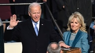 Joe Biden is sworn in as the 46th president of the United States by Chief Justice John Roberts as Jill Biden holds the Bible during the 59th Presidential Inauguration at the U.S. Capitol in Washington, Jan. 20, 2021.