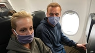 Leading Kremlin critic Alexei Navalny and his wife Yulia are seen onboard a plane before the departure for Moscow at the Airport Berlin Brandenburg in Schoenefeld, near Berlin, Germany, Jan. 17, 2021.