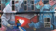 A worker adds finishing touches to giant mural tribute to frontline workers in the COVID-19 pandemic outside a hospital in Kuala Lumpur, Malaysia.