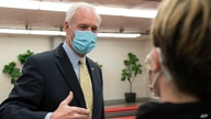 Sen. Ron Johnson, R-Wis., answers reporters after leaving the Senate floor, Jan. 26, 2021, on Capitol Hill in Washington.
