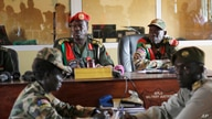 FILE - Judges sit in the courtroom during a trial at a court in the capital Juba, South Sudan, May 30, 2017. The country has announced plans to create a hybrid court to deal with atrocities commited during its years of conflict.