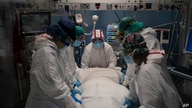 A medical team prepares to rotate a COVID-19 patient in the ICU of the Hospital del Mar, in Barcelona, Spain, Jan. 19, 2021.