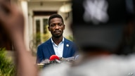 FILE - Leading opposition candidate in Uganda's presidential election Bobi Wine speaks to the press outside Kampala, Uganda, Jan. 15, 2021, one day after Ugandans went to the polls.