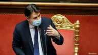 FILE - Italian Prime Minister Giuseppe Conte speaks ahead of a confidence vote at the upper house of parliament, in Rome, Jan. 19, 2021.